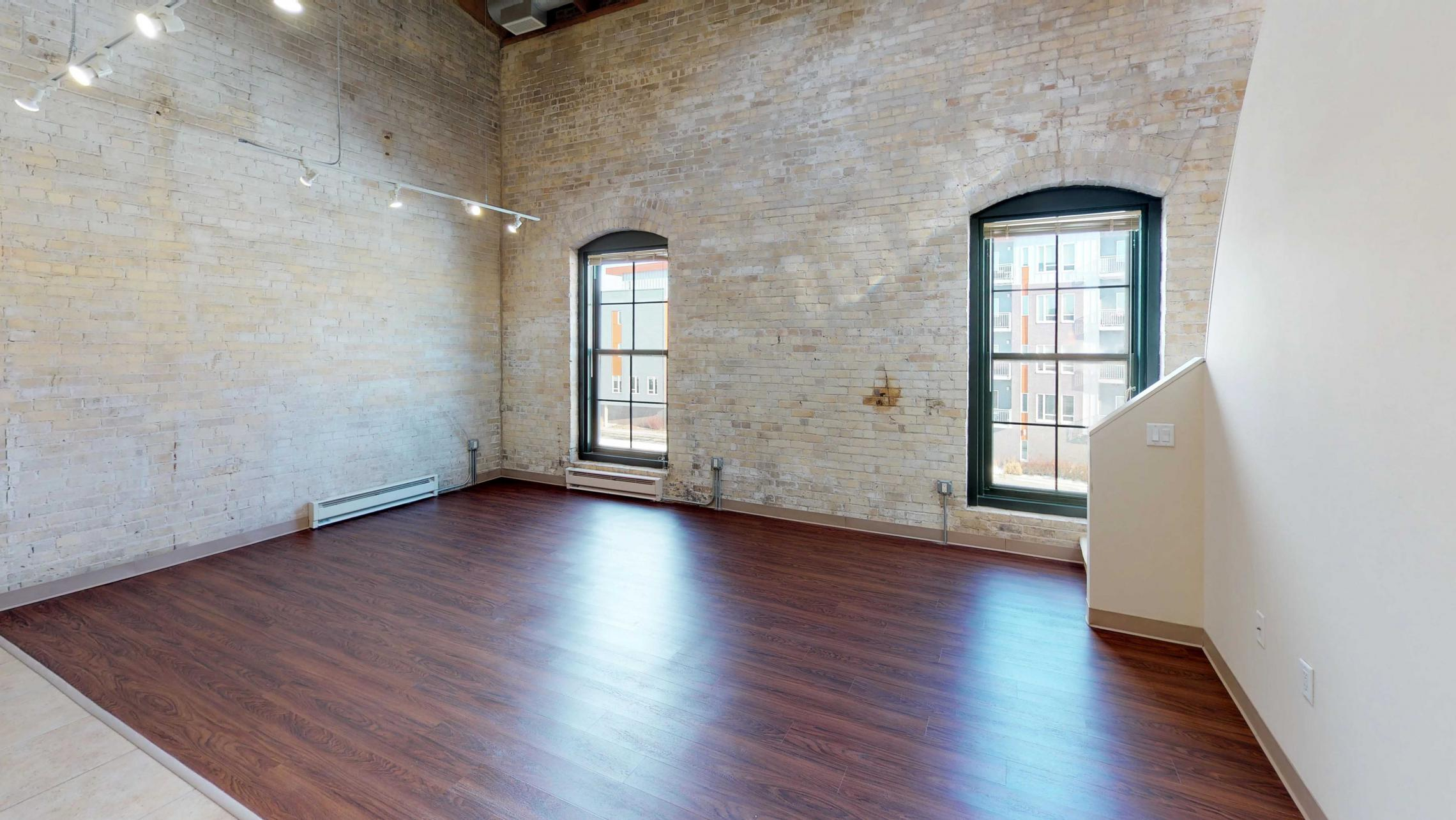 E307-Historic-Downtown-Lofted-Two-Bedroom-Madison-Exposed-Brick-Design-Beams-Dining-Tobacco-Lofts