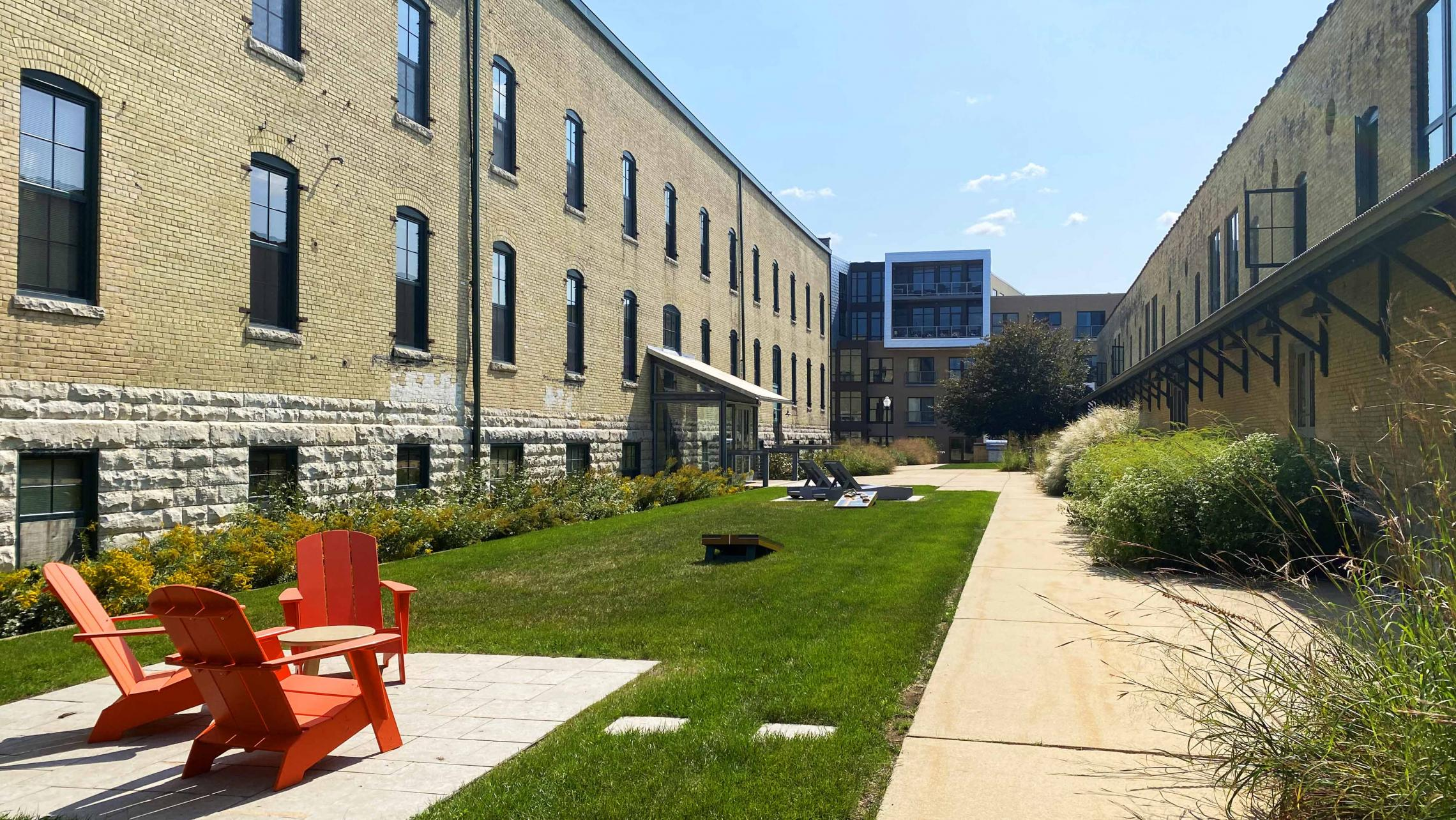Tobacco-Lofts-Yards-Apartments-Historic-Exposed-Timber-Brick-Lounge-Coutyard-Grill-Fitness-Cats-Bike-Path-Lake-Downtown-Madison