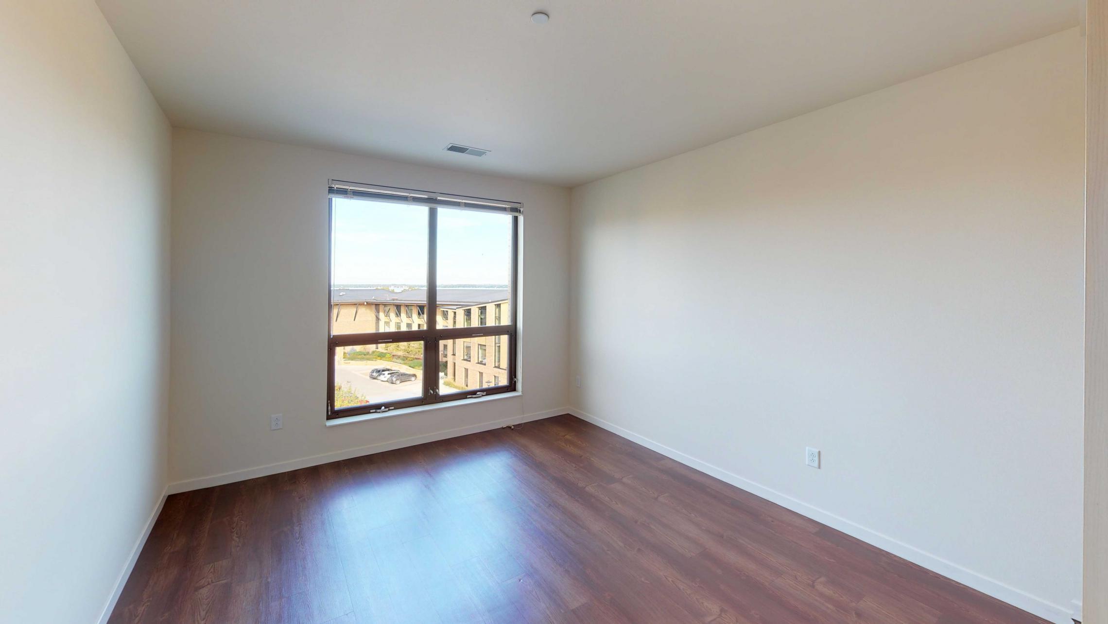 Nine-Line-Apartment-517-bedroom-lake-view-capitol-city-downtown-balcony-modern-luxury-upscale.jpg