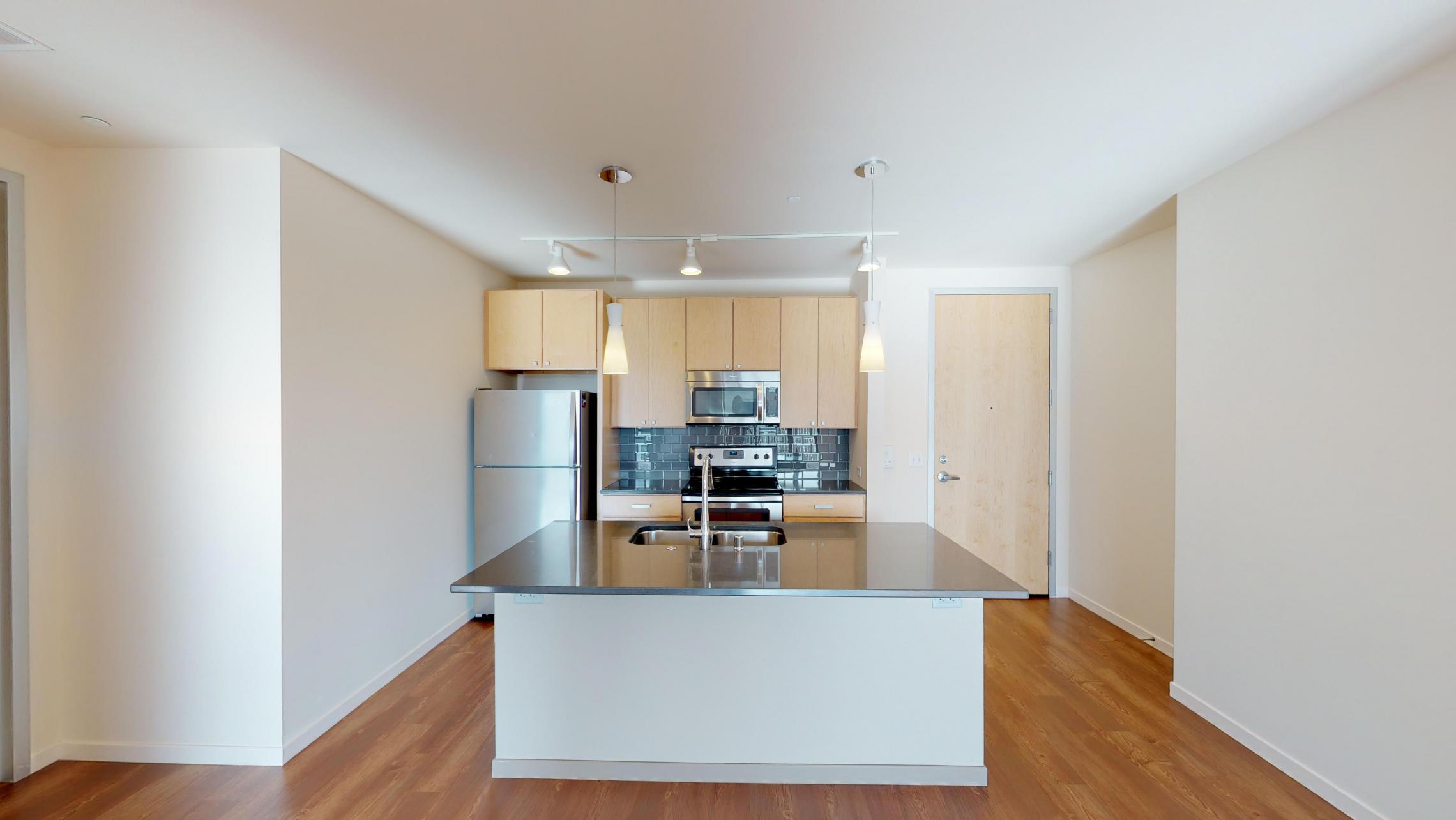 Nine-Line-Apartment-520-bedroom-modern-upscale-luxury-lifestyle-madison-views-balcony-downtown-city