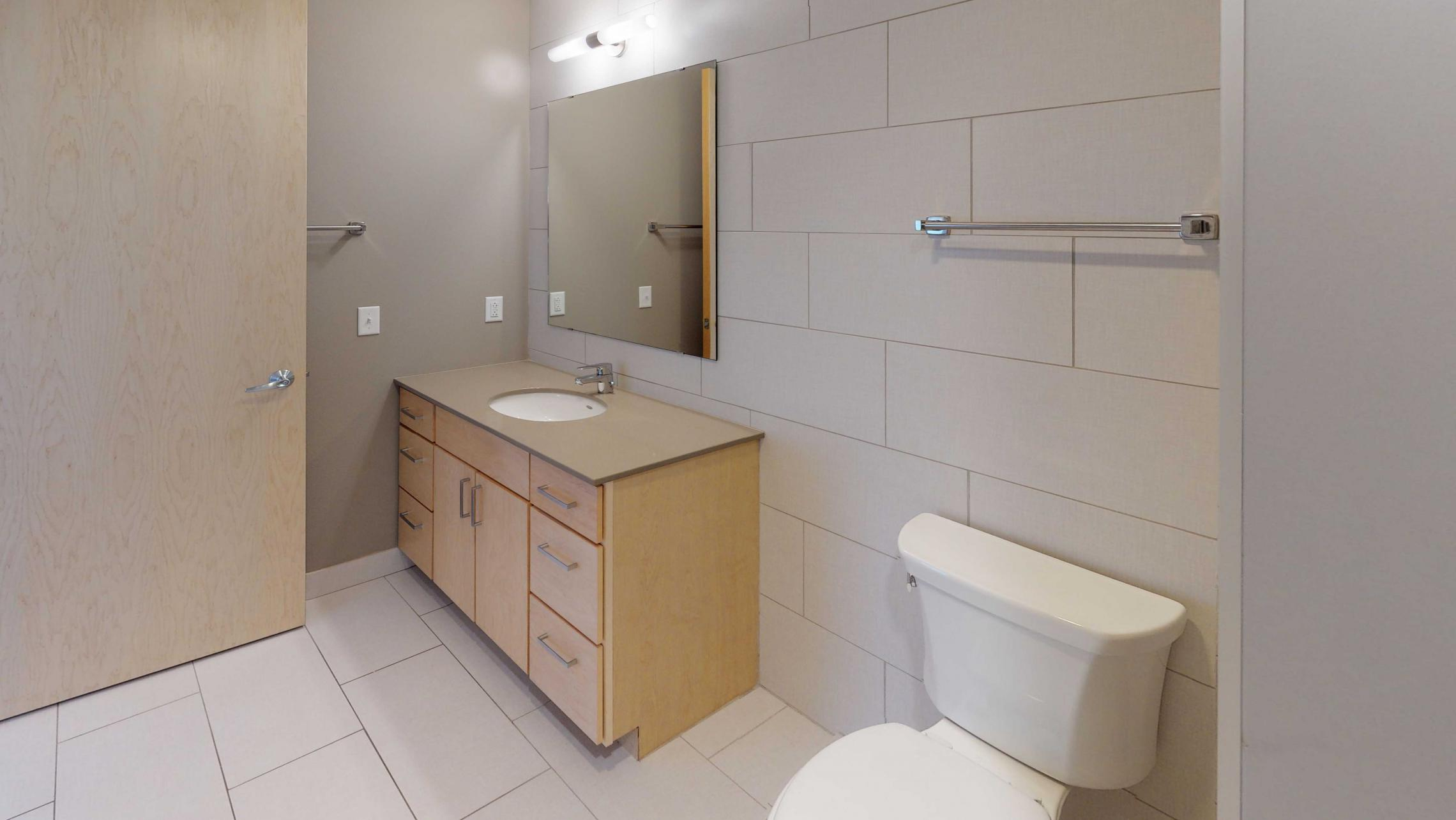 Nine-Line-Apartment-517-Modern-Bathroom-Details-Madison-Upscale-Views-Downtown.jpg