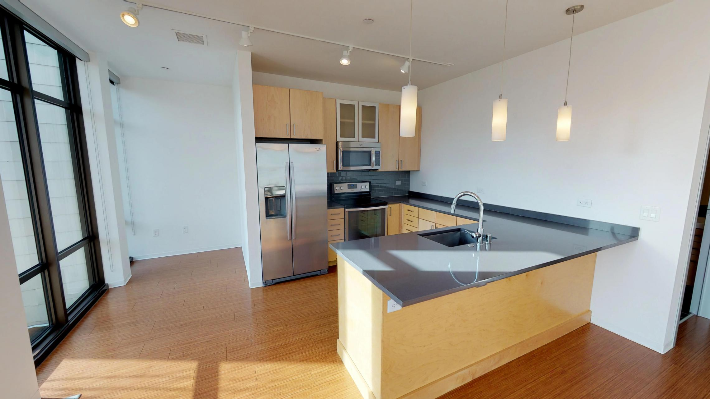 SEVEN27-Apartment-101-Kitchen-modern-lake view-downtown-large windows- corner - tow bedroom