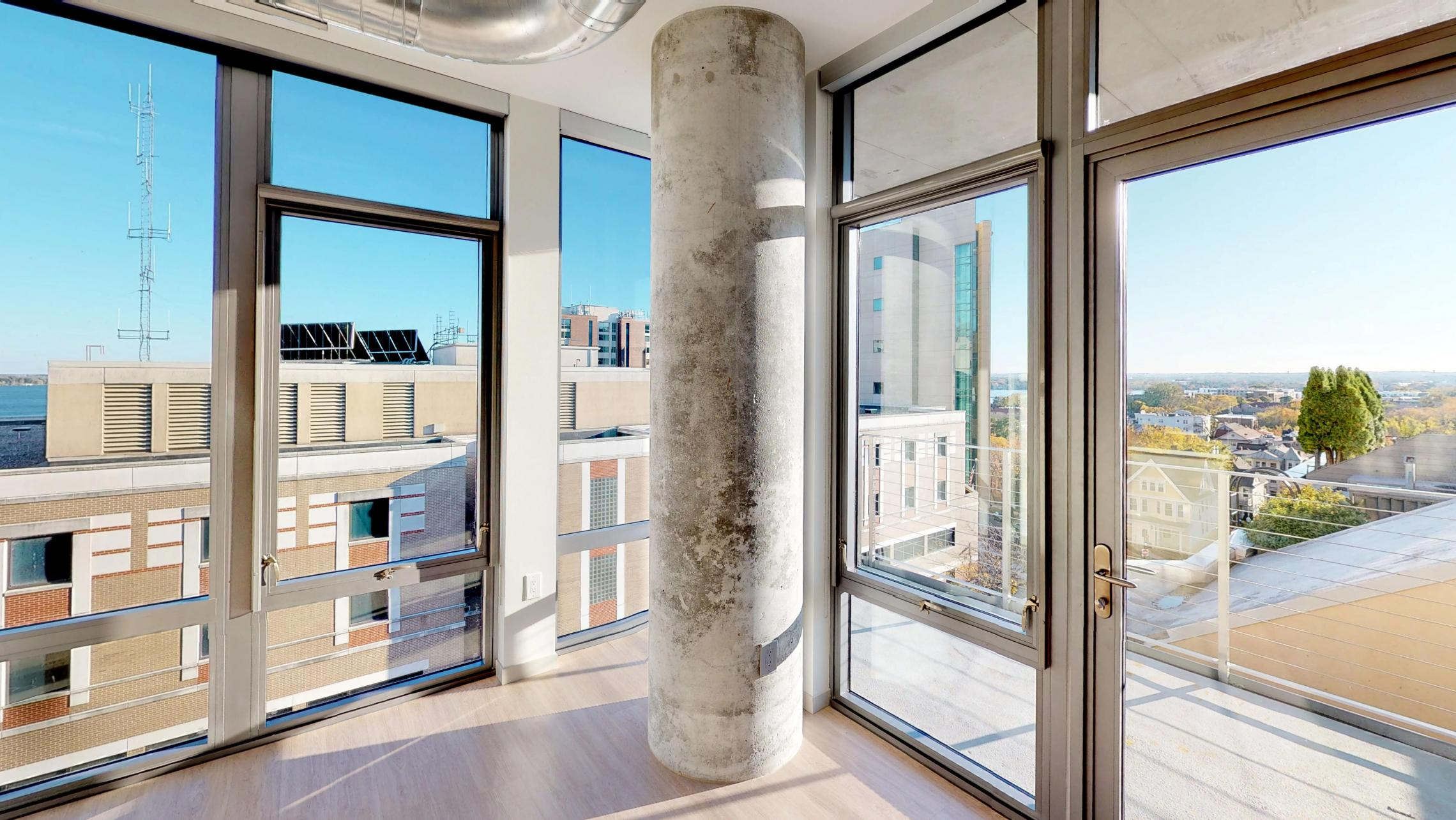 The-Pressman-Apartment-513-One-Bedroom-Living-Room-View-Kitchen-Island-Downtown-Madison-Capitol-Balcony-Views.jpg
