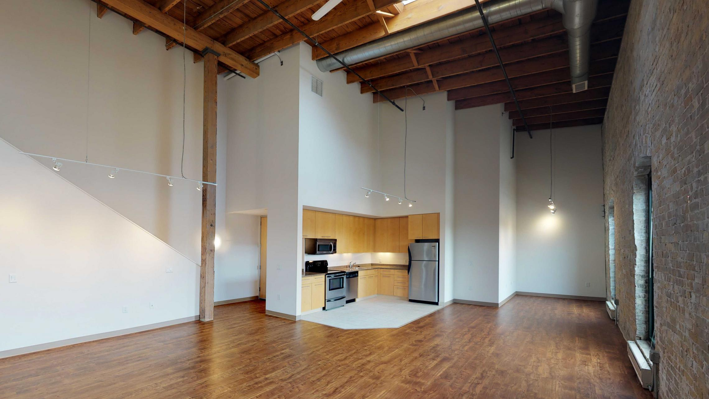 Tobacco-Lofts-Apartment-E306-Historic-Lofted-Two-Bedroom-Downtown-Madison-Yards-Exposures-Brick-Design.jpg