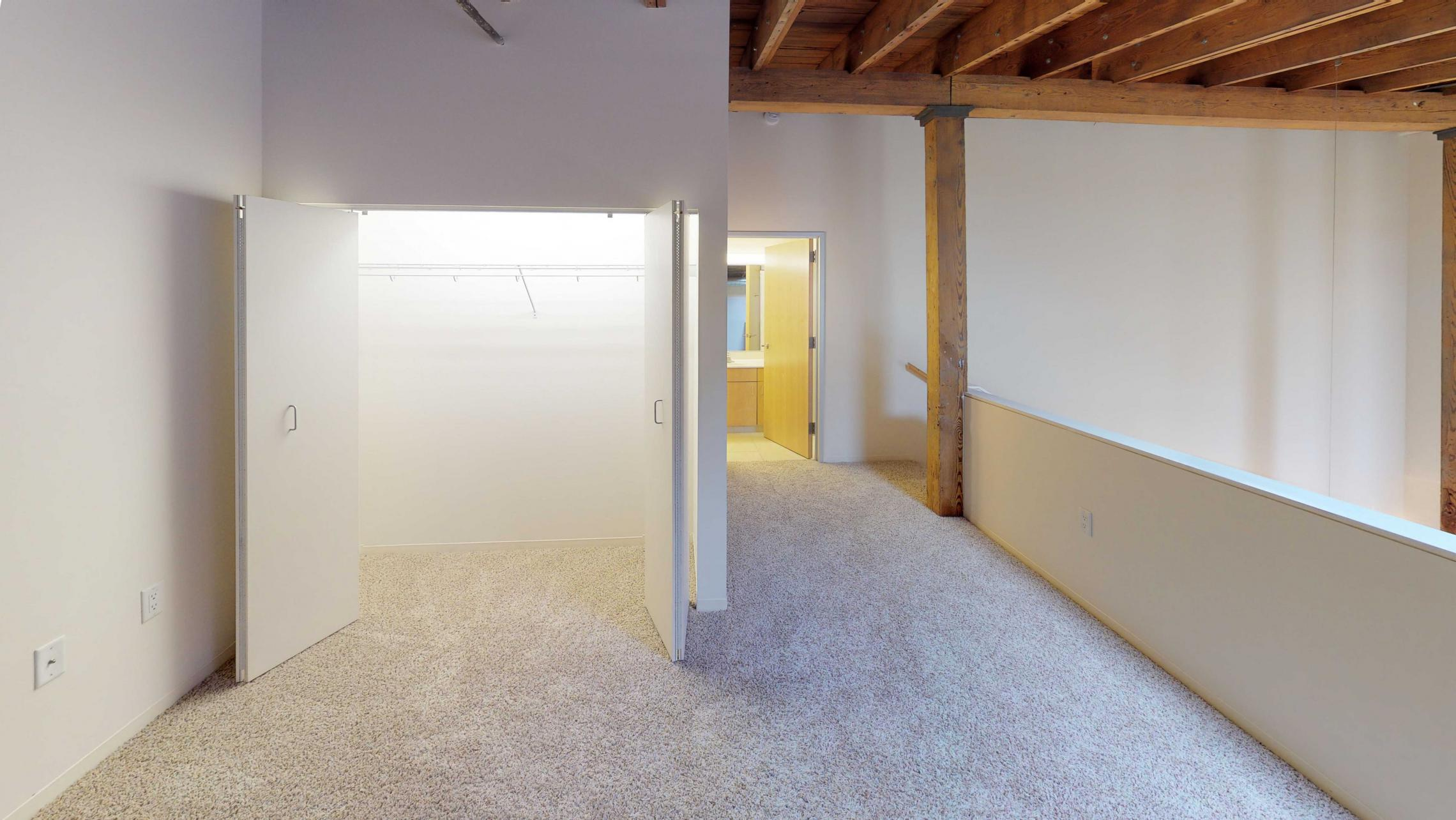 Tobacco-Lofts-Apartment-E306-Lofted-Historic-Two-Bedroom-Downtown-Madison-Exposures-Beams-Vaulted