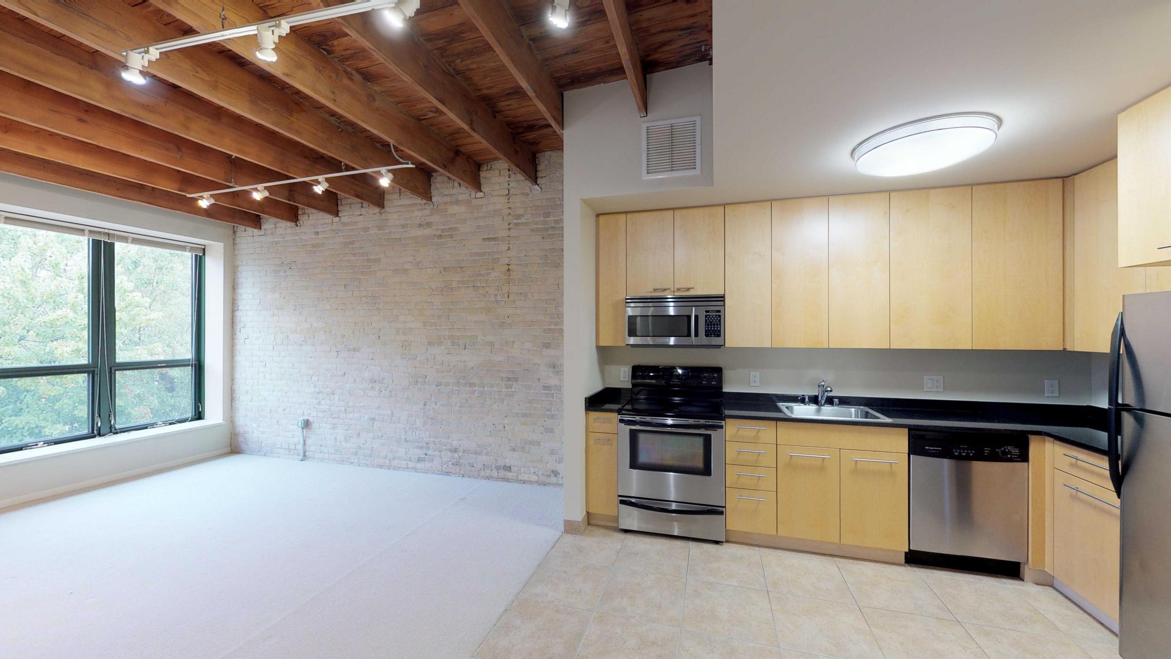 Tobacco-Lofts-Apartment-W220-Studio-Historic-Downtown-Tobacco-Lofts-Apartment-W220-Studio-Historic-Downtown-Madison-Yards-Kitchen-Exposures-BrickMadison-Yards-Kicthen-Exposures-Brick.jpg