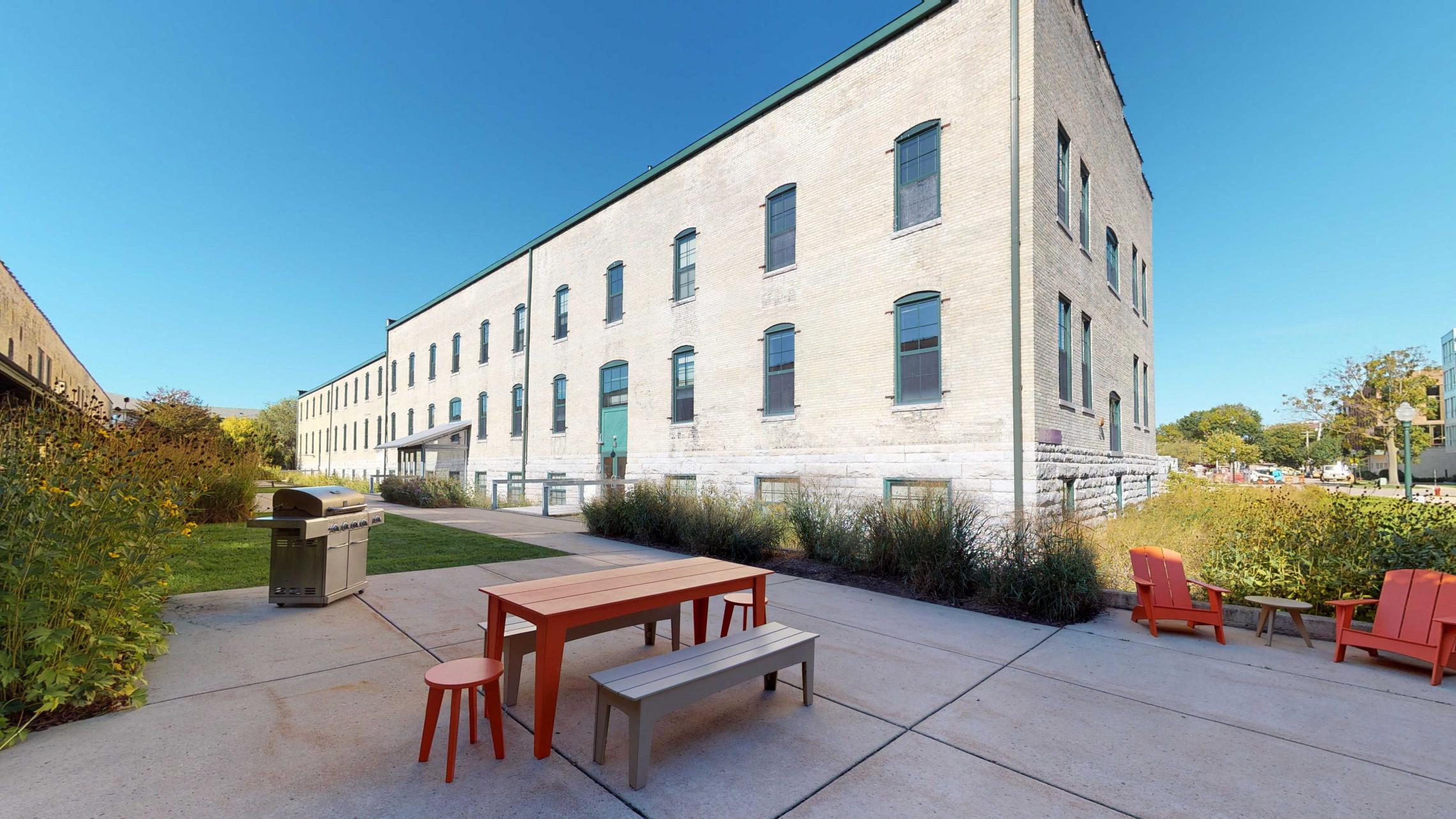 Tobacco-Lofts-Courtyard-Historic-Apartments-Design-Brick-Downtown-Madison-Yards-Boccie-Grill-Bike-Picnic-Dining