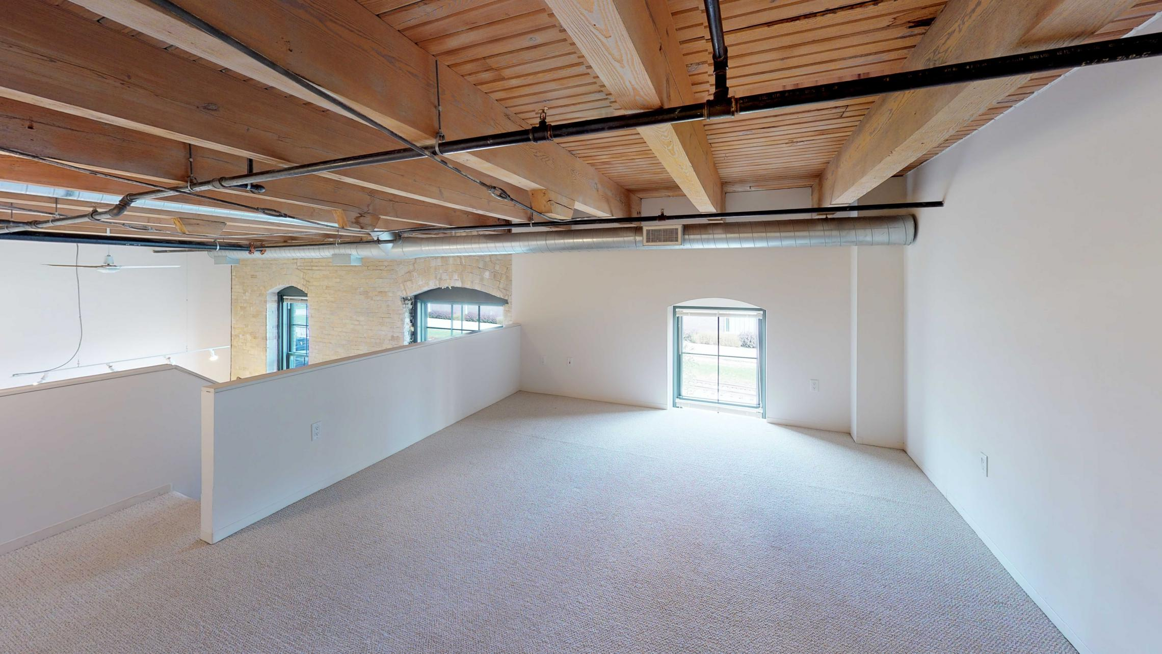 Tobacco-Lofts-E203-Lofted-Two-Bedroom-Downtown-Madison-Balcony-Exposed-Brick-Design-Historic.jpg