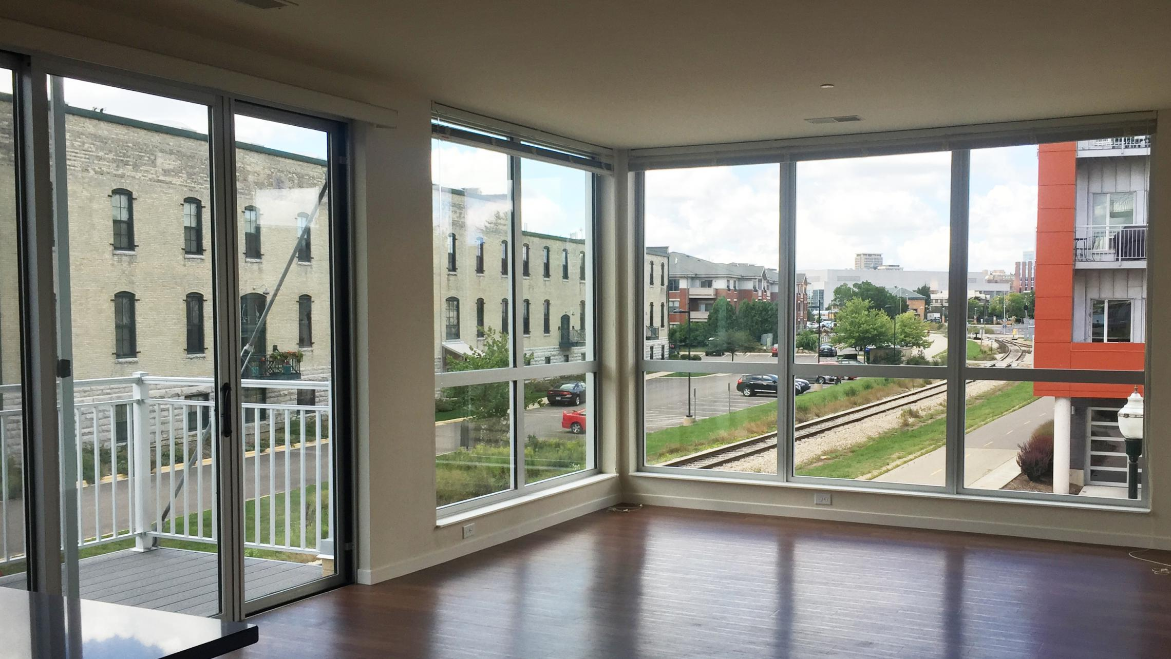 ULI Nine Line Apartment 314 - Living Room with view of Tobacco Lofts