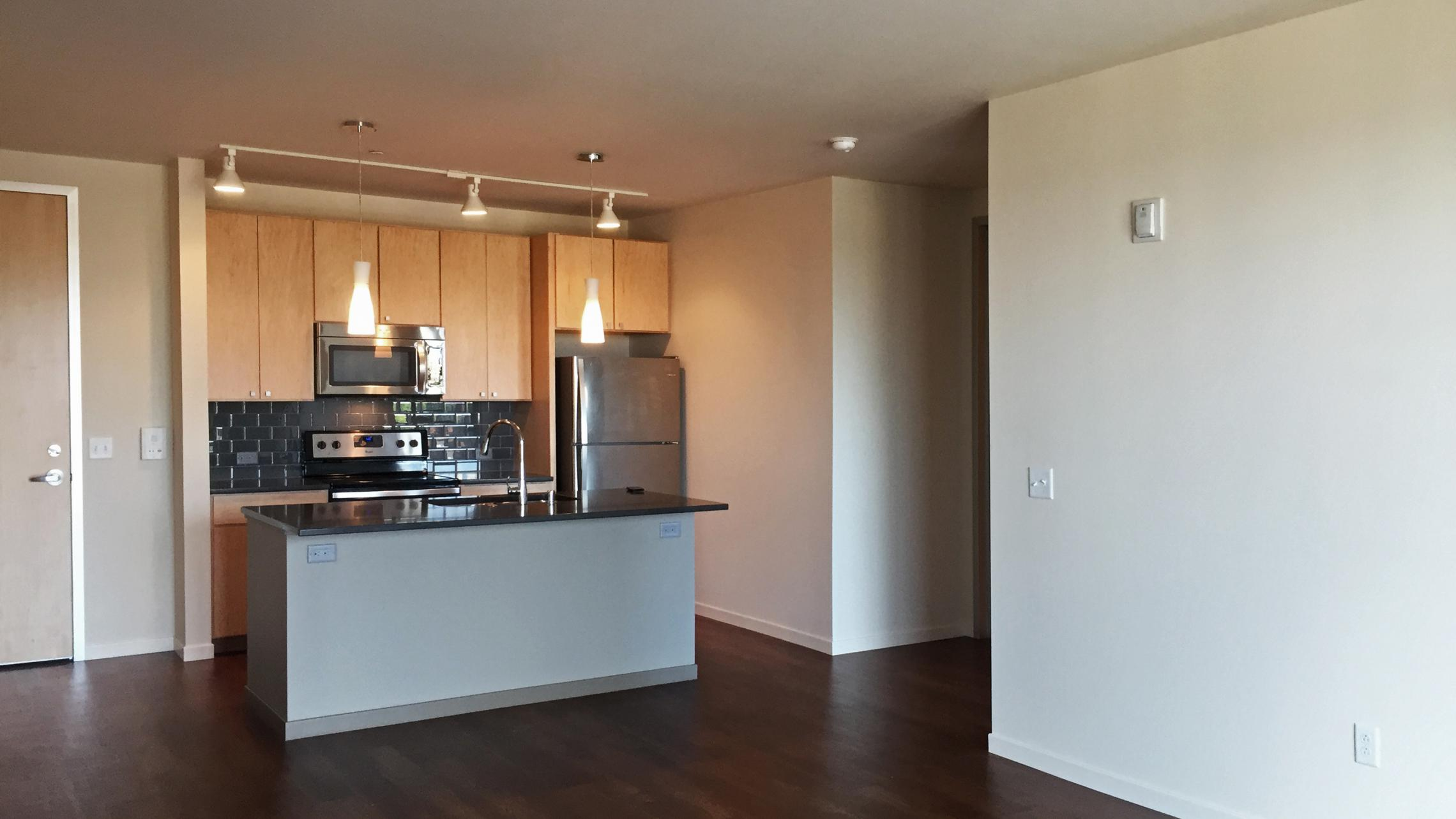 ULI Nine Line Apartment 319 - Kitchen and Living Area
