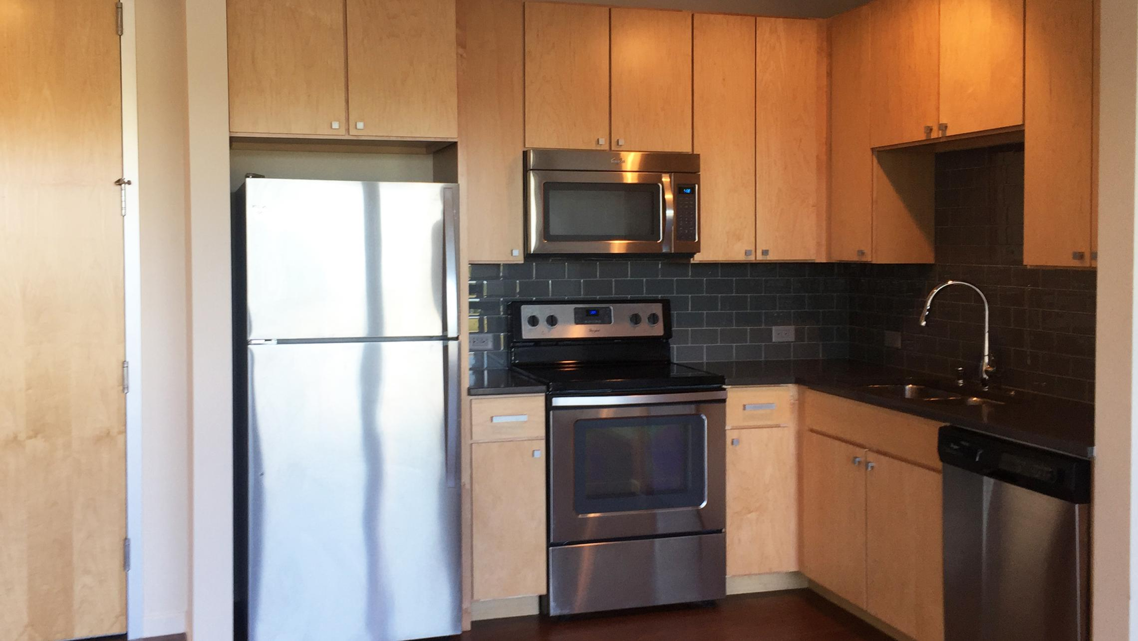 ULI Nine Line Apartment 409 - Kitchen with Stainless Steel Appliances