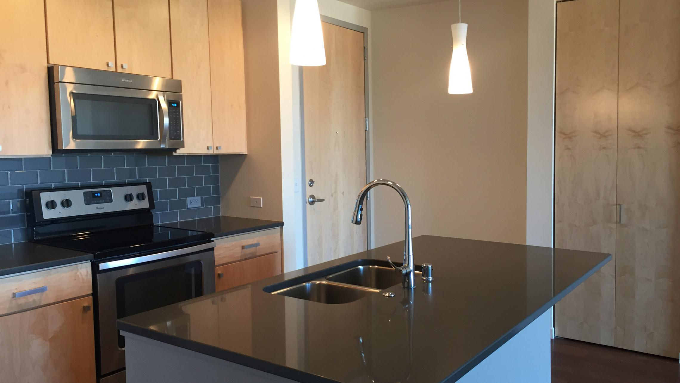 ULI Nine Line Apartment 420 - Kitchen with Stainless Steel Appliances