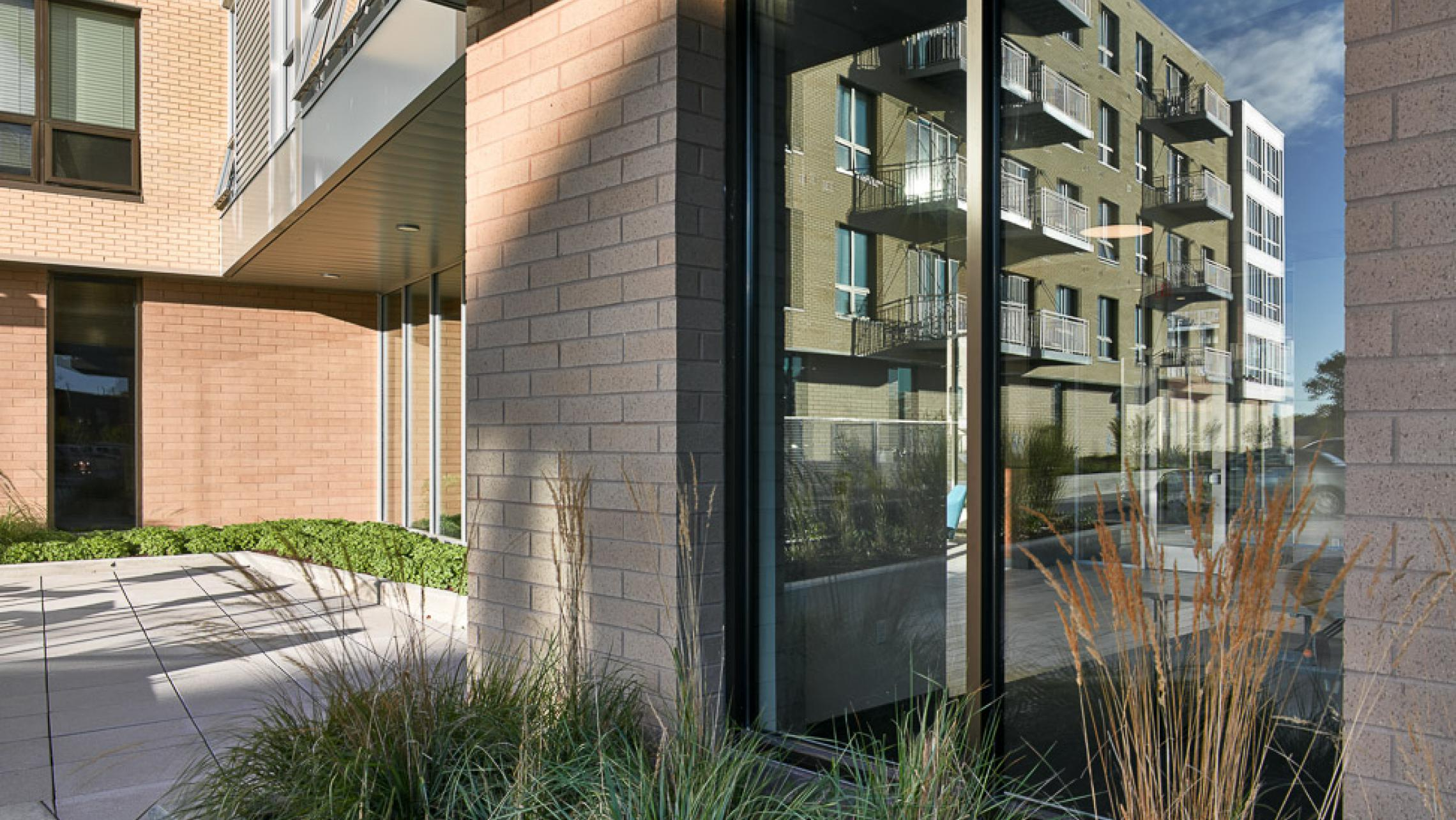ULI Nine Line Apartments - Reflections at the Entrance