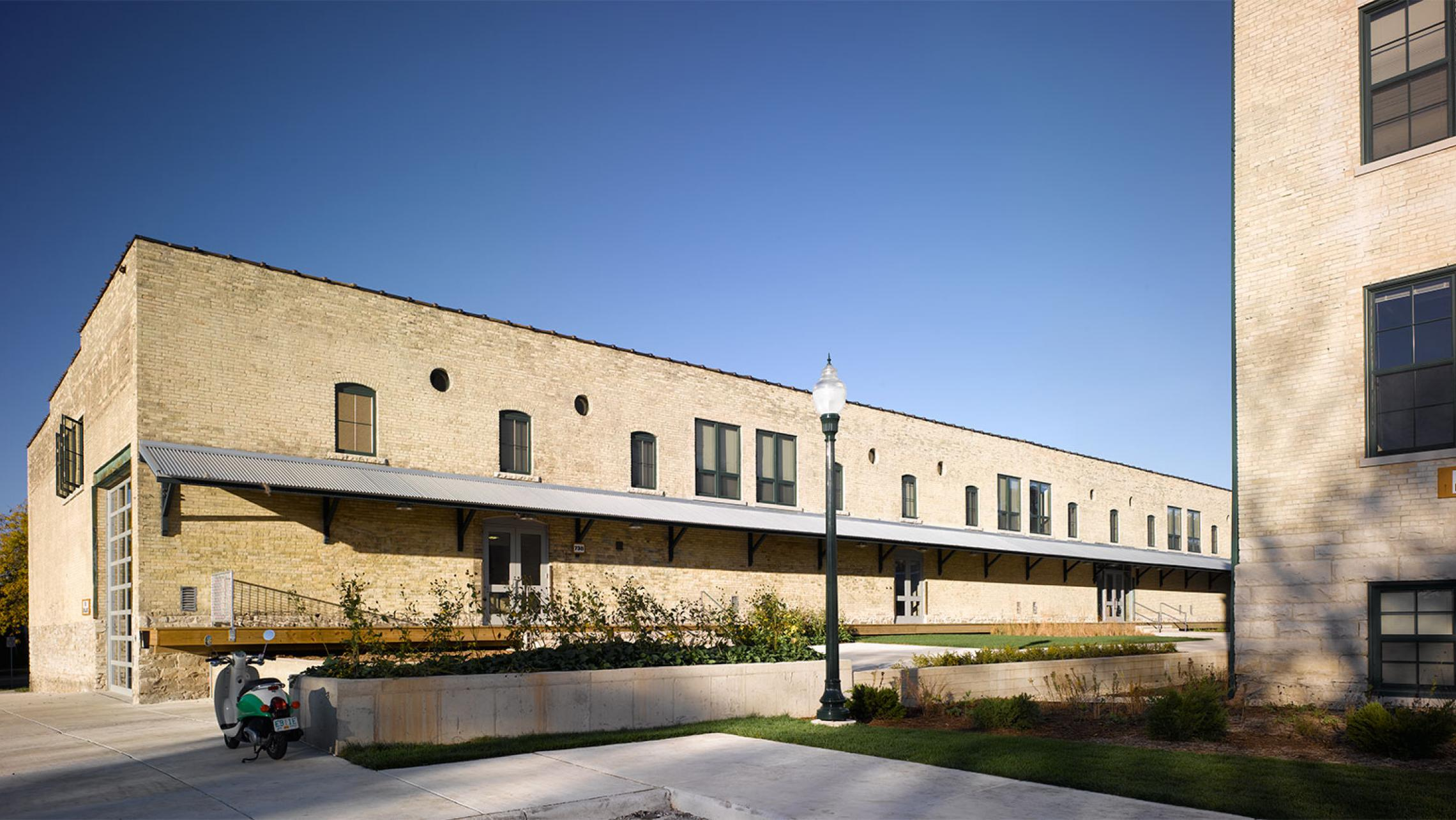 ULI Tobacco Lofts Apartments - Exterior View Adaptive Reuse