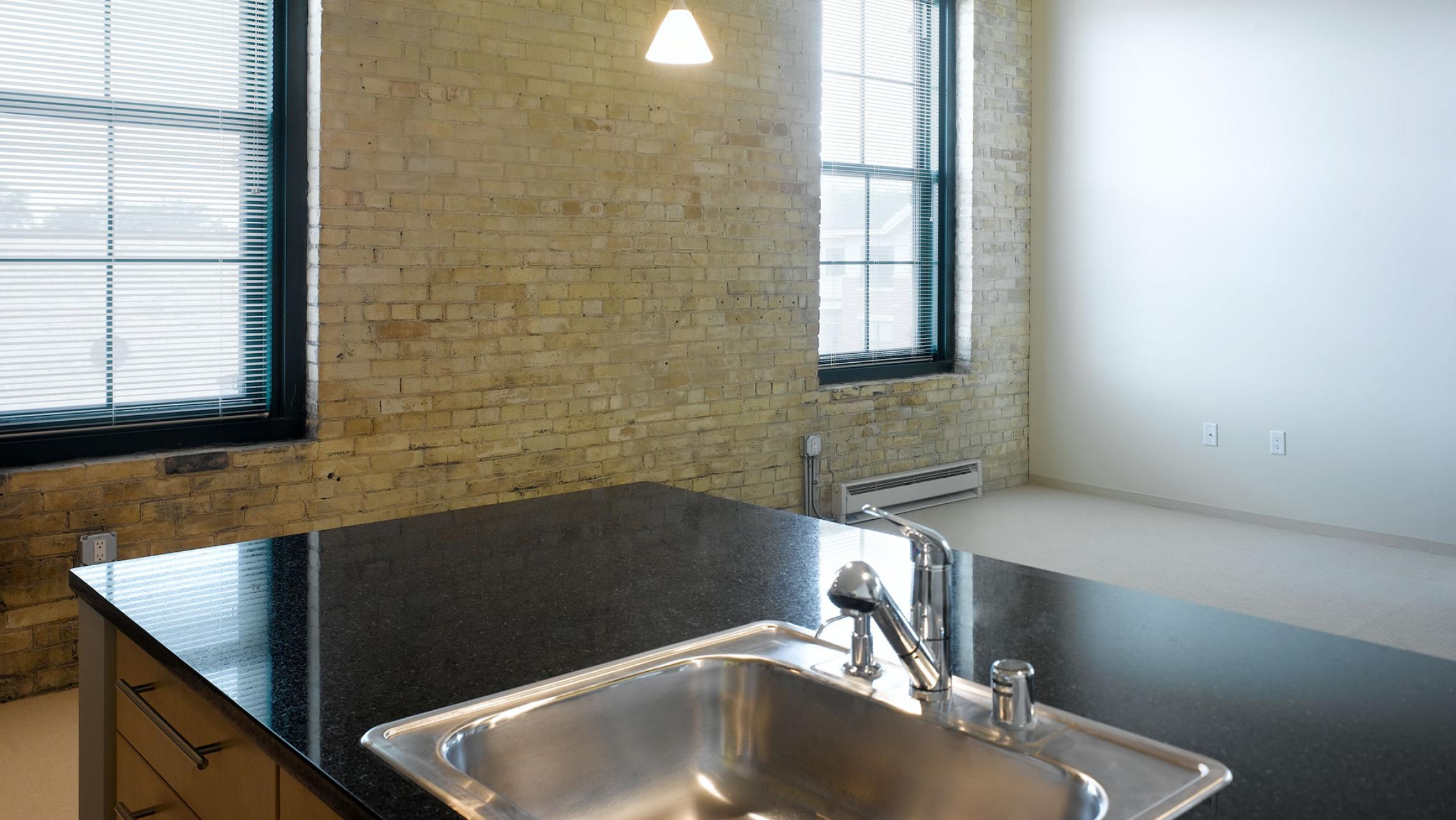 ULI Tobacco Lofts Apartments - Kitchen with High End Finishes