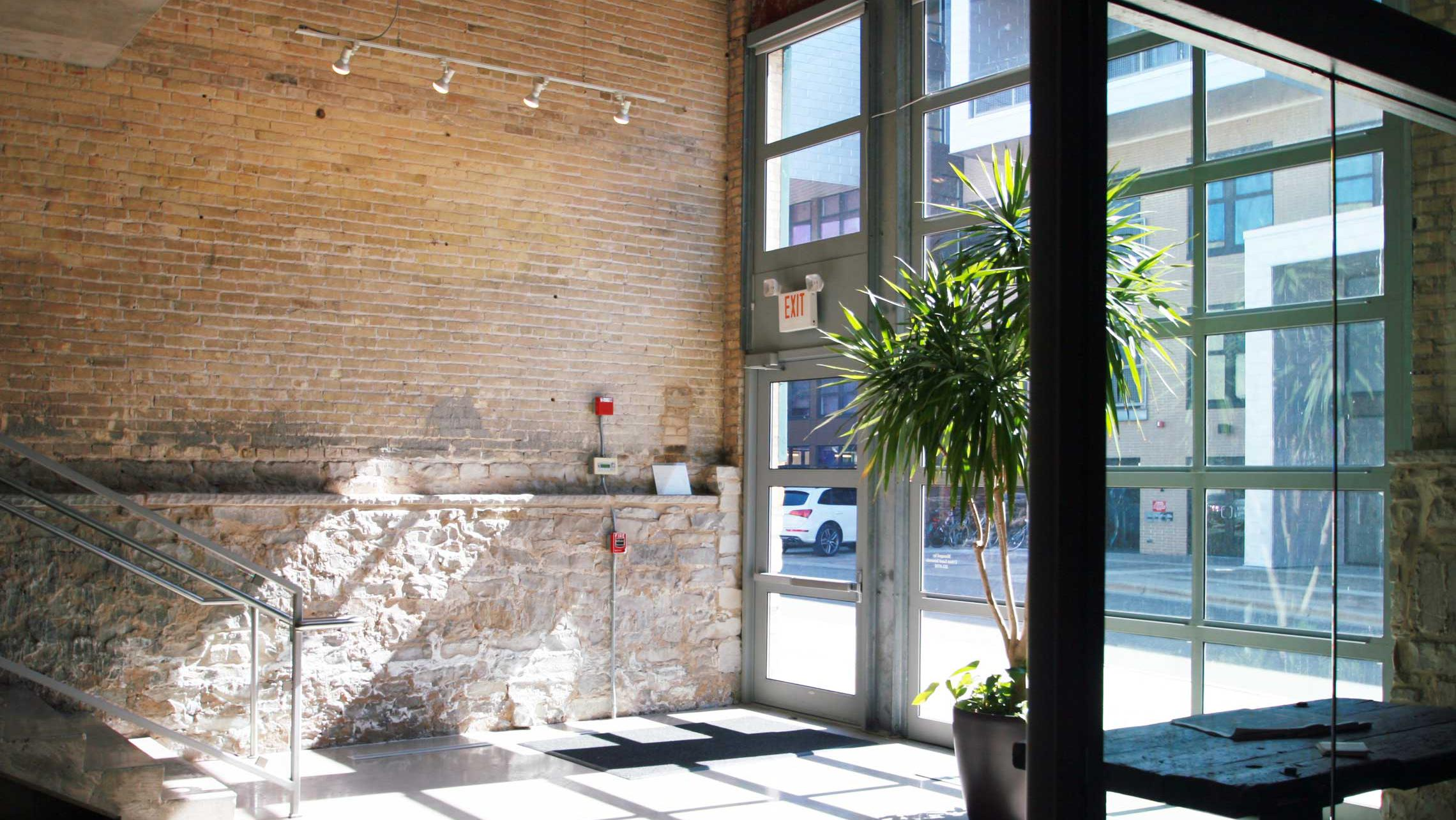 ULI Tobacco Lofts Apartments - Lobby with Exposed Brick