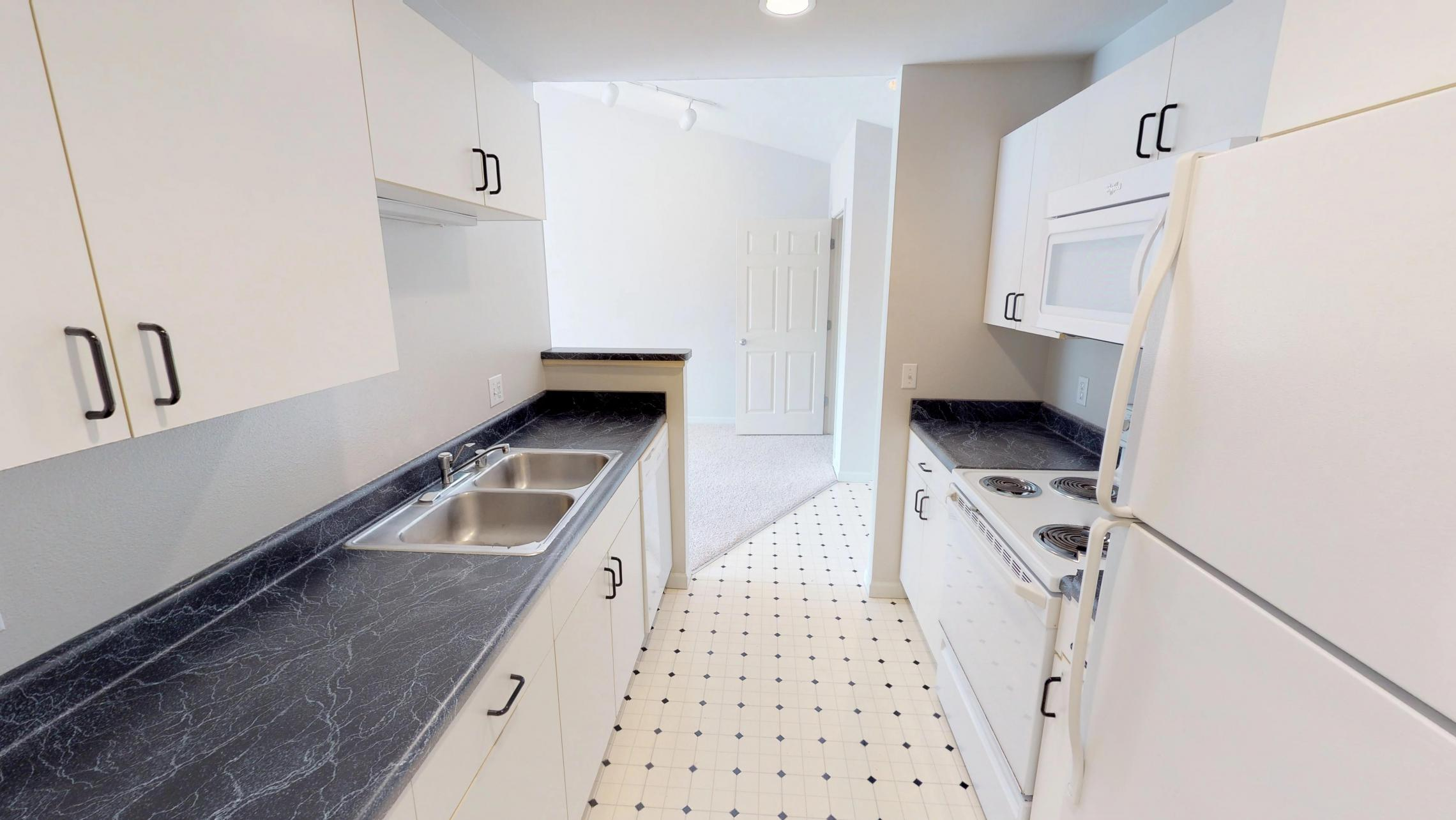 Wilson-Bay-Apartments-303-one bedroom-kitchen-dinning room-downtown-balcony