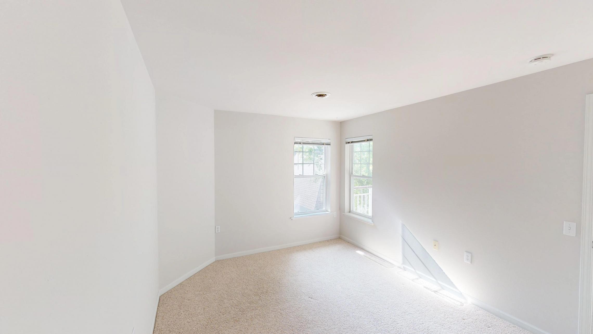 Wilson-Bay-Apartments-303-one bedroom-bedroom-corner-downtown-balcony