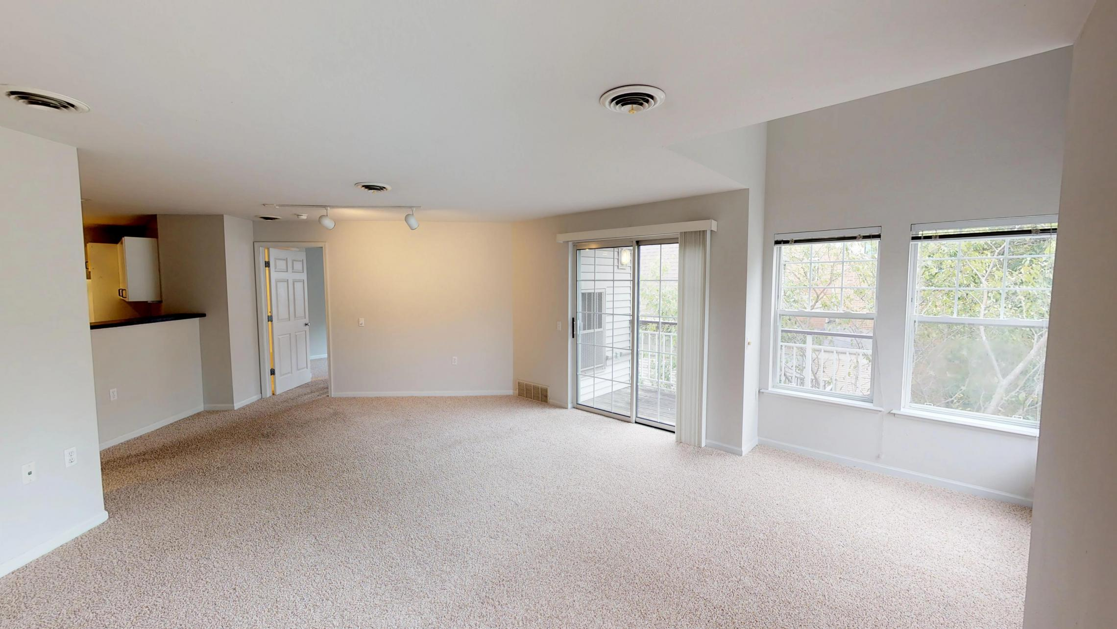 Wilson-Bay-Apartments-306-one bedroom-living room-dinning room-downtown-balcony