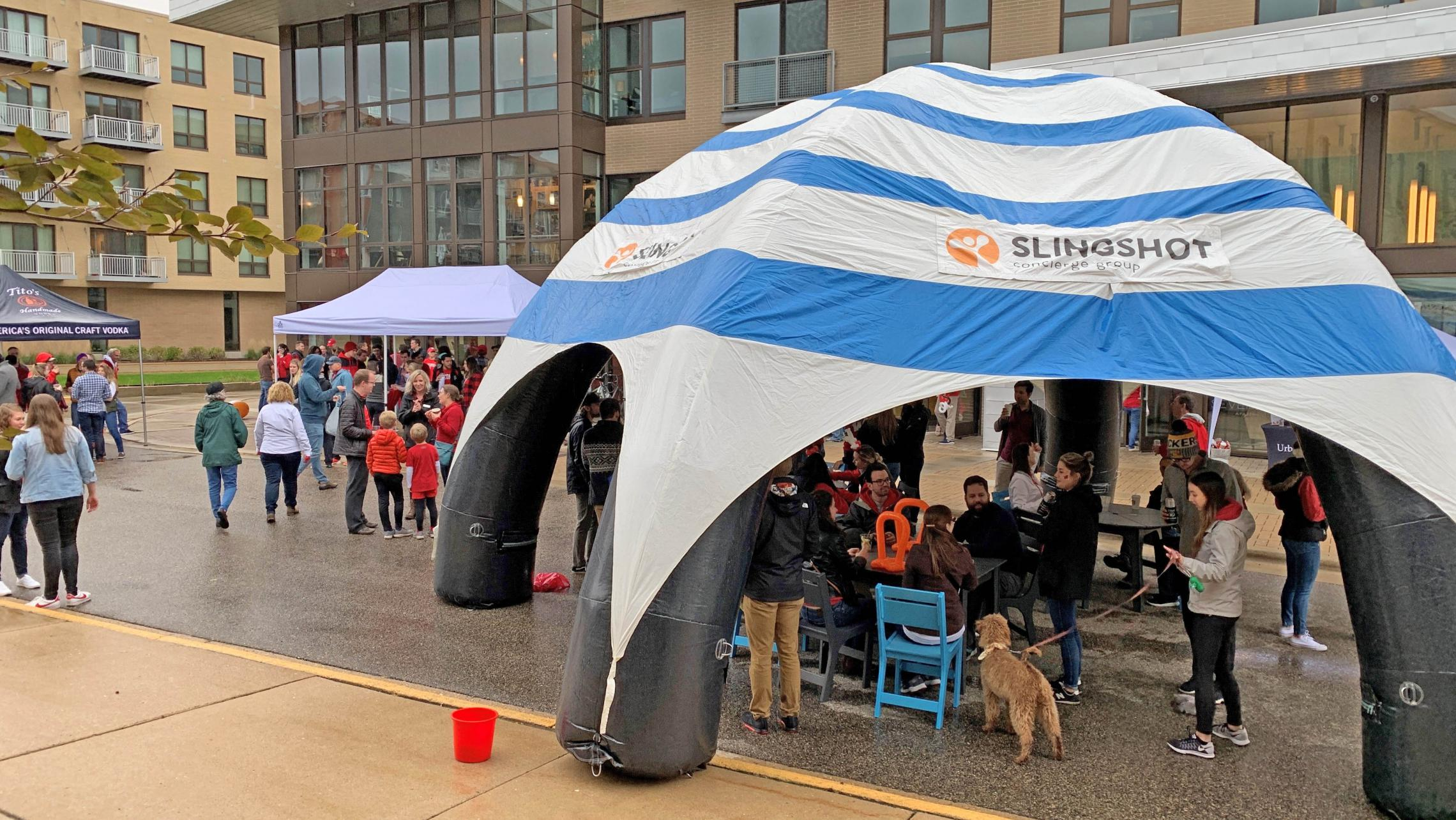 Residents enjoying ULI's second annual tailgate under a tent provided by S-Concierge