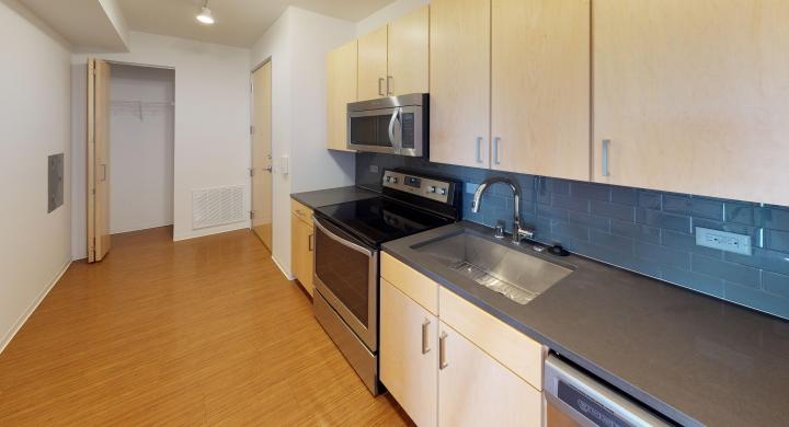SEVEN27-Apartment-115-studio-lake view-modern-upscale-downtown-madison-patio-courtyard-living room-kitchen.jpg